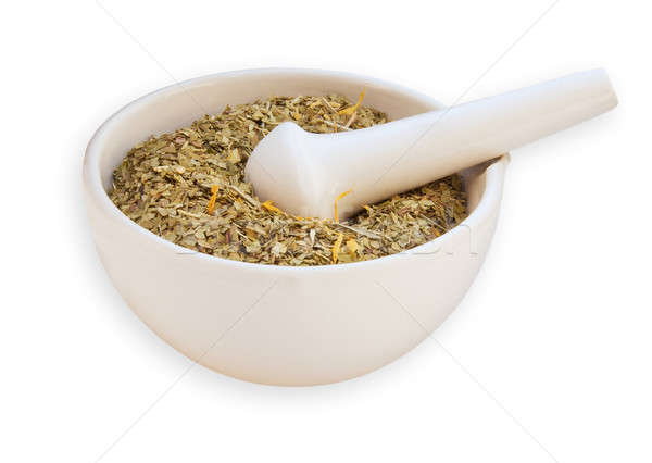 mortar and pestle with dry herbs isolated on white background Stock photo © Avlntn