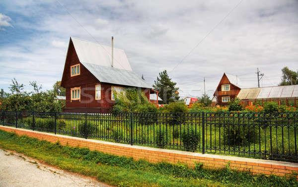 Estate cottage bella casa albero nubi Foto d'archivio © Avlntn