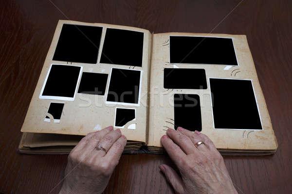 Vintage mãos velho livro madeira Foto stock © Avlntn