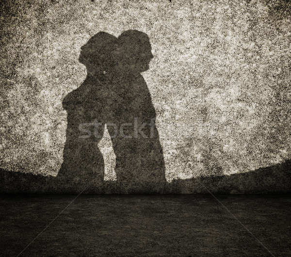 shadow of the man and the woman on wall Stock photo © Avlntn