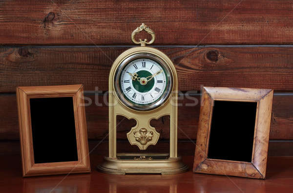 old photo frames and antique clock Stock photo © Avlntn