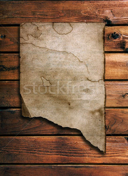 ragged  old paper on brown wood wall Stock photo © Avlntn