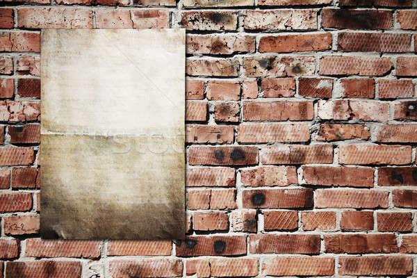 paper on brickwall Stock photo © Avlntn