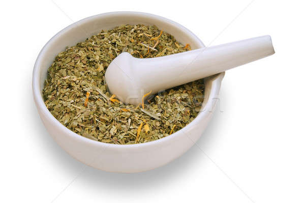 mortar and pestle with dry herbs on white background Stock photo © Avlntn