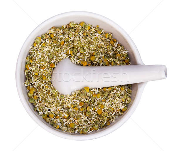 mortar and pestle with dry herbs Stock photo © Avlntn