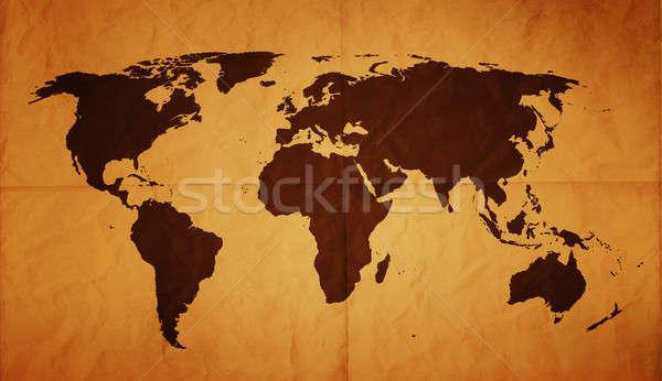öreg világtérkép összehajtva régi papír foltok térkép Stock fotó © axstokes