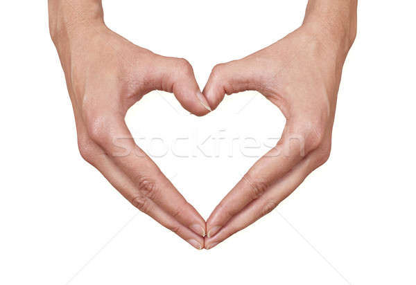 heart shape made of two female hands Stock photo © axstokes