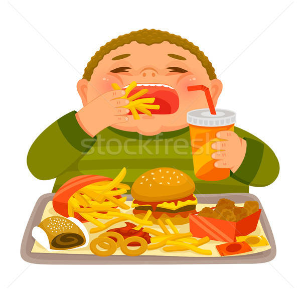 Boy binge eating junk food Stock photo © ayelet_keshet