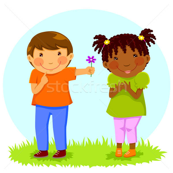 Stock photo: boy gives flower to girl