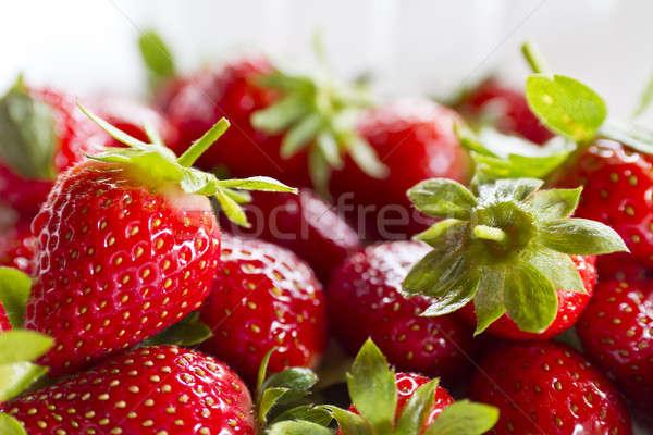 Strawberries on White close up Stock photo © azamshah72