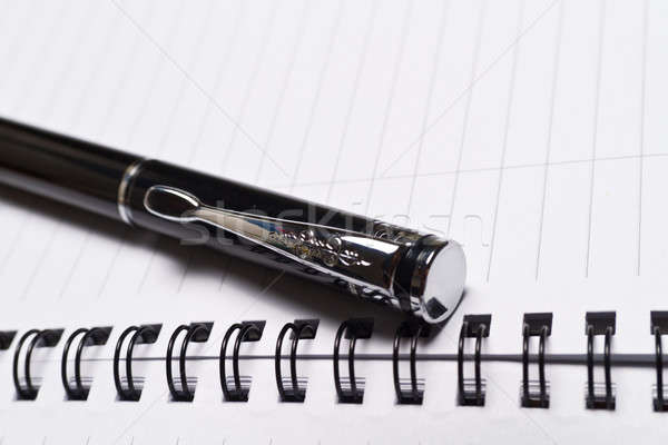 Opened Note Book and a Pen Stock photo © azamshah72