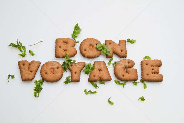 Bon Voyage Biscuits and Leaves Stock photo © azamshah72