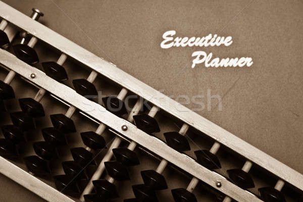 Financial Planning Concept in Sepia Stock photo © azamshah72