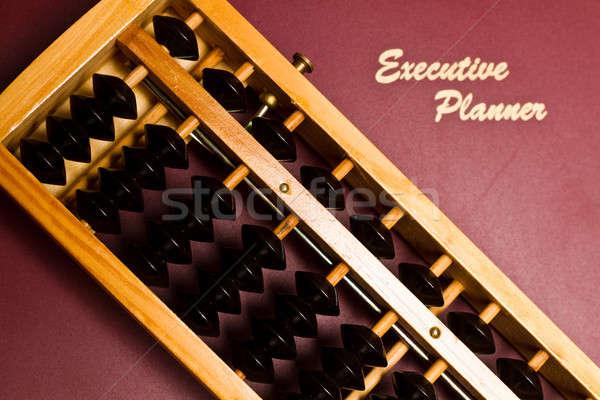 Pénzügyi tervezés fókuszál abakusz felső igazgató tervező Stock fotó © azamshah72