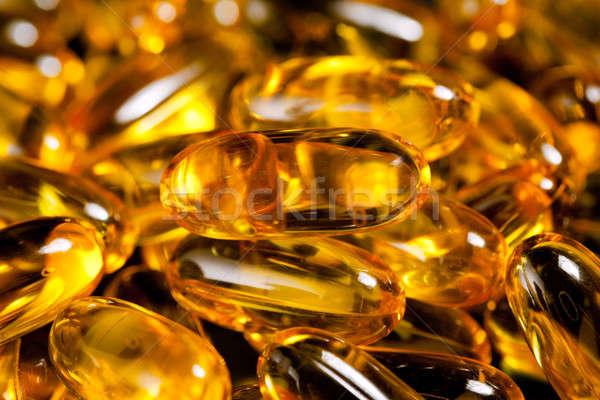 Close up of fish oil capsules Stock photo © backyardproductions