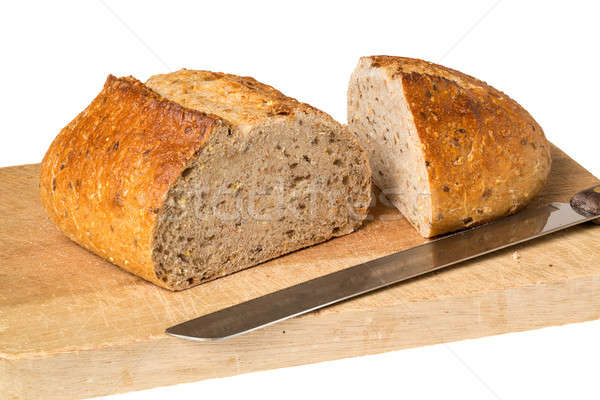 Artisan whole wheat bread on breadboard Stock photo © backyardproductions