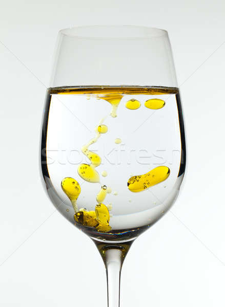 Olive oil being poured into wine glass Stock photo © backyardproductions
