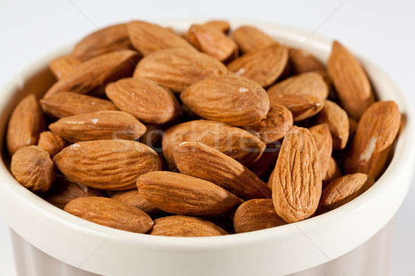 Raw organic almonds in bowl Stock photo © backyardproductions
