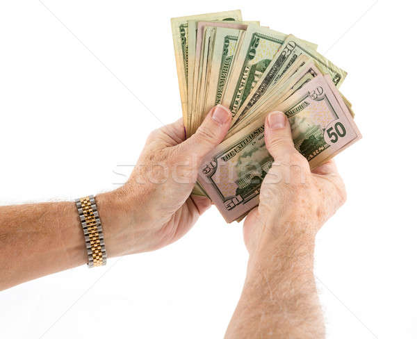 Caucasian ethnicity hands holding fan of US dollar bills Stock photo © backyardproductions