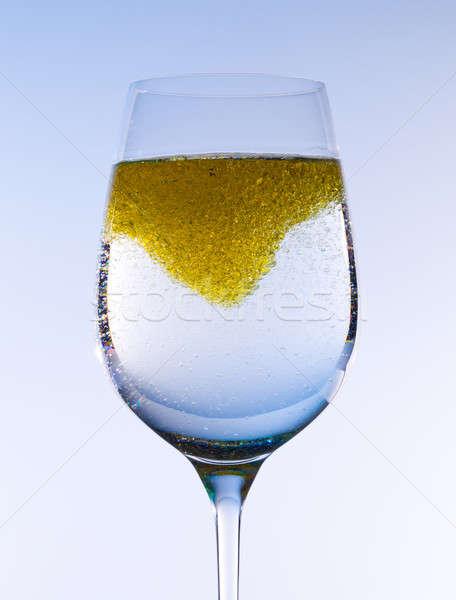 Olive oil stirred into wine glass Stock photo © backyardproductions