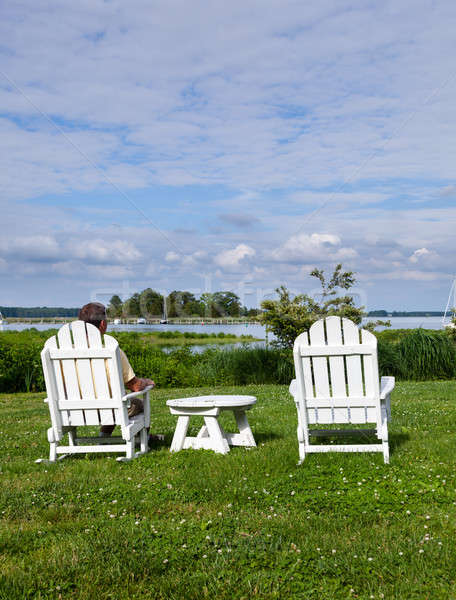 Single senior man in white chairs overlooking bay Stock photo © backyardproductions