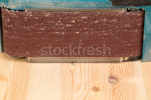 Side view of belt sander on pine wood Stock photo © backyardproductions