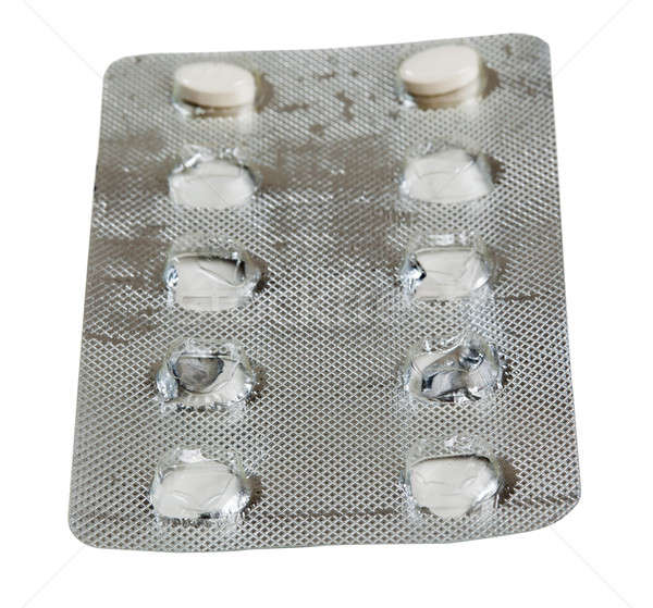 Foil packet for tablets with two white tablets Stock photo © backyardproductions