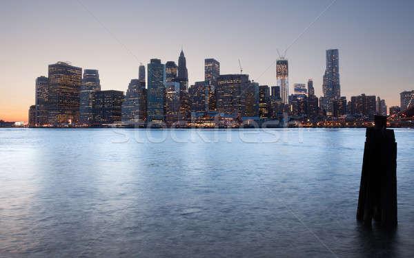 Híd alsó Manhattan naplemente nap épületek Stock fotó © backyardproductions