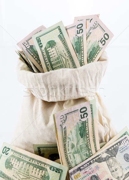 Many US dollar bills or notes with money bags Stock photo © backyardproductions