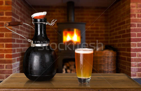 Growler and glass of beer at home Stock photo © backyardproductions