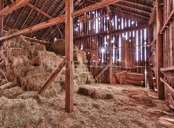 Interior of old barn with straw bales Stock photo © backyardproductions