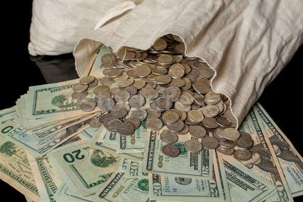 Many US dollar bills or notes with money bag Stock photo © backyardproductions