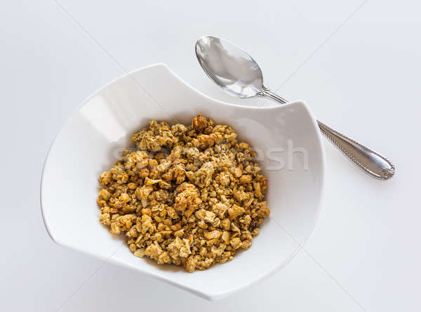 Bowl of organic granola with spoon Stock photo © backyardproductions