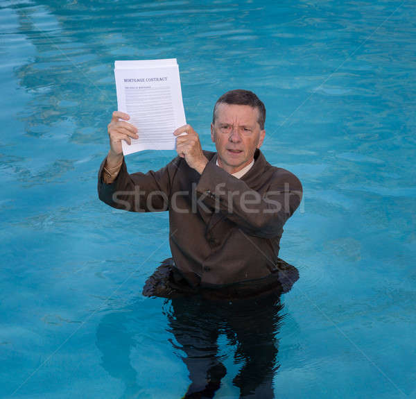 Senior man holding mortgage loan document in water Stock photo © backyardproductions