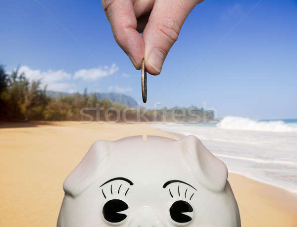 Saving money in piggy bank with fingers Stock photo © backyardproductions
