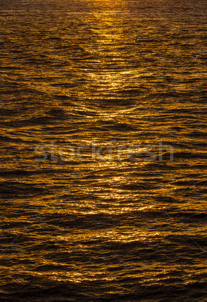 Pattern of ripples in the ocean reflecting sun Stock photo © backyardproductions