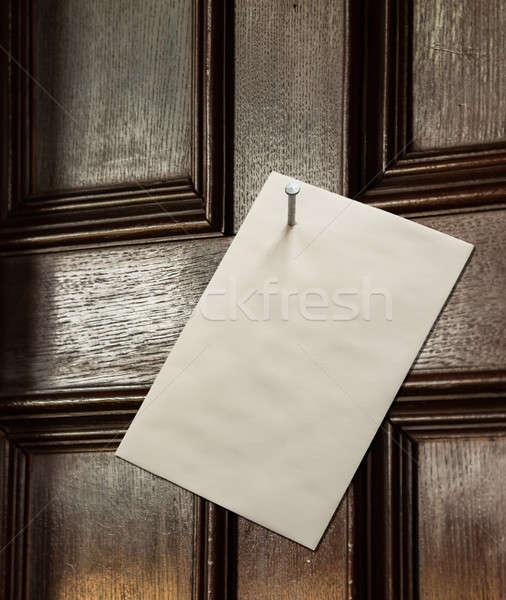 Envelope nailed to wooden door Stock photo © backyardproductions