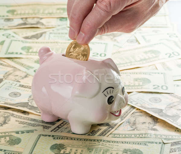 Hand gouden munt spaarvarken vingers sleuf 20 Stockfoto © backyardproductions