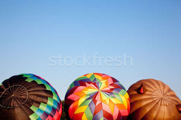 Three Hot air balloons being inflated Stock photo © backyardproductions