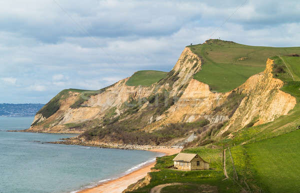 Cottage by cliffs at West Bay Dorset in UK Stock photo © backyardproductions