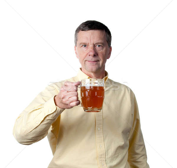Stock photo: Middle aged man with pint of beer