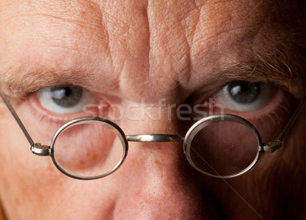 Senior man with focus on glasses Stock photo © backyardproductions