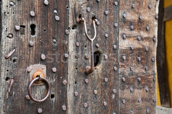 Heavily studded oak door at entrance to castle Stock photo © backyardproductions