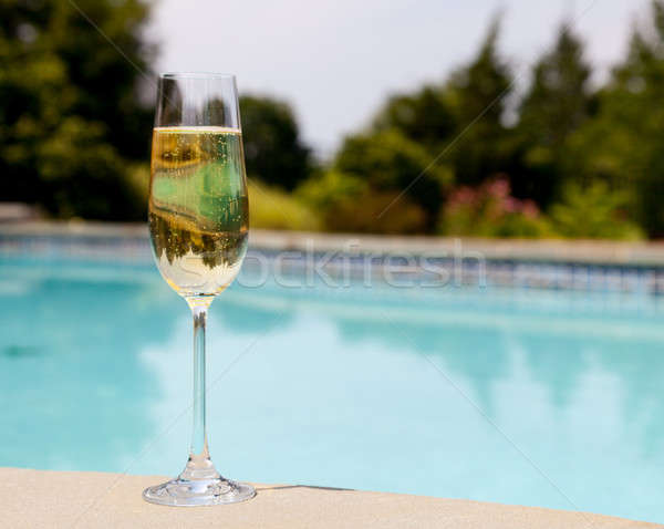 Flute of cold champagne by side of pool Stock photo © backyardproductions