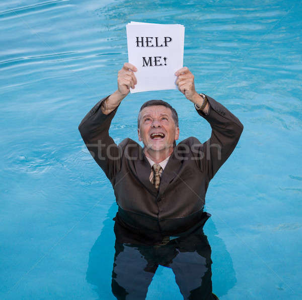 Senior man holding help me paperwork in water Stock photo © backyardproductions
