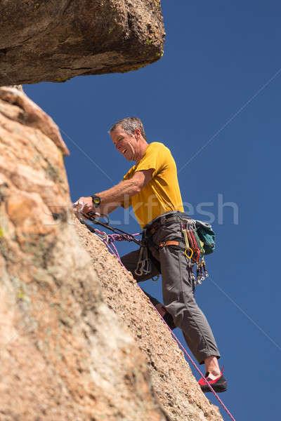 Idős férfi felső kő mászik Colorado Stock fotó © backyardproductions