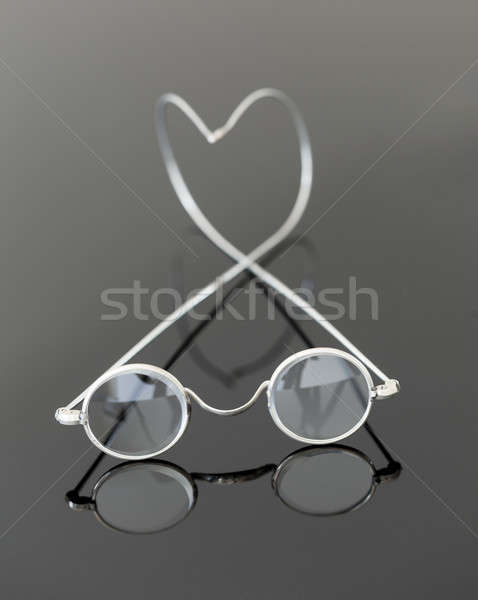 Pair of old magnifying reading glasses  Stock photo © backyardproductions