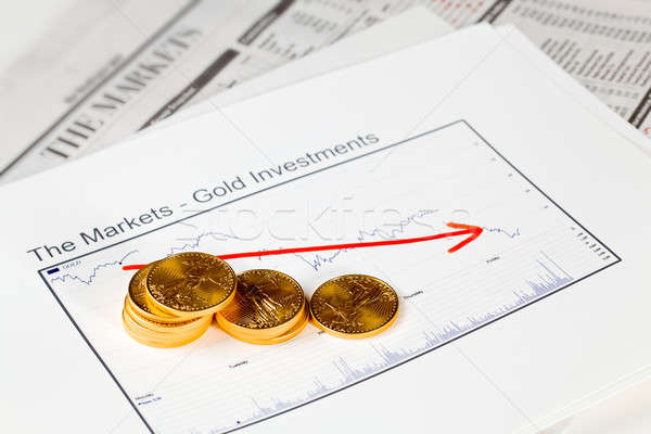 Golden Eagle coins on newspaper Stock photo © backyardproductions