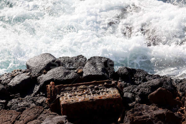 Old engine block dumped by sea Stock photo © backyardproductions