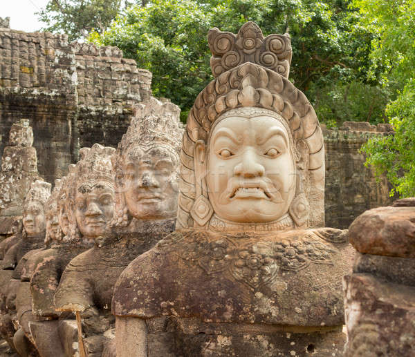 Demons line entrance to south gate angkor thom Stock photo © backyardproductions